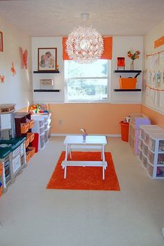 Orange is supposed to invigorate the mind :) Perfect for our orange and white playroom!
