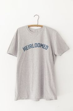 """Our new style collection celebrates all those that love to treasure hunt through vintage markets + antique stores, marvel at abandoned antebellum homes and work to preserve the history from days past.Our """"Heirloomed"""" shirt is featured on a light grey vintage wash t-shirt in our signature navy blue color. This shirt is an ode to those who cherish family heirlooms, and create new ones to pass down for generations to come. Unisex fit / design. Antebellum Homes, Navy Blue Color, Vintage Market, Antique Stores, Preserve, Custom Made, Abandoned, Graphic Tees, Marvel"""
