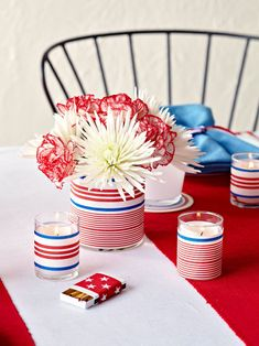 Top your July 4th tablescape with a few patriotic decorations—like these homemade candle holders and vases. Make these centerpieces your own with red, white, and blue patterned paper. Simply attach to the clear vessels using adhesive. #redwhiteandblue #4thofjuly #4thofjulyparty #partyideas #4thofjulydecorations #bhg Happy Fourth Of July, 4th Of July Party, July 4th, Homemade Candle Holders, July Flowers, Blue Centerpieces, 4th Of July Decorations, Memorial Day, Flower Arrangements