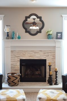 Stacked stone fireplace. By Jenna Halvorson Designs