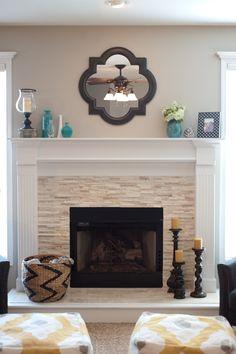 Stacked stone fireplace. By Jenna Halvorson Designs