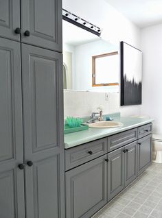 Paint over oak cabinetry, tile, and metal. This budget-friendly bathroom makeover used only paint and Rust-Oleum cabinet refinishing system.