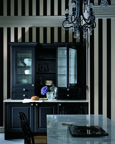 Black cabinetry with marble countertops are offset marvellously with elegant black and white striped walls. #grundig #kitchen #trends #inspiration #design #ideas #blackandwhite #stripes #blackcupboard #elegant