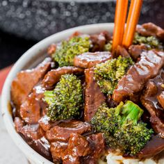 Easy Beef and Broccoli Stir Fry Recipe Main Dishes with olive oil, flank steak, low sodium soy sauce, corn starch, garlic, sherry, honey, fresh ginger, sesame oil, red pepper flakes, Sriracha, beef broth, broccoli