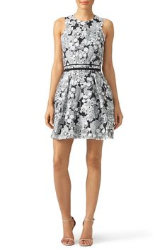 This patterned Carven mini dress is graphic and feminine. We love the patterned Engagment Party look with chunky black heels.
