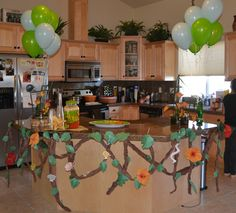 Decorate for jungle theme baby shower. Made vines and leaves from butcher paper! Cheap and easy and really cute! Cool Vines hanging from tables Jungle Theme Birthday, Jungle Theme Parties, Safari Party, Baby 1st Birthday, Jungle Party, Birthday Ideas, Baby Shower Themes, Baby Shower Decorations, Shower Ideas