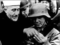 Amin Al Husseini with one of his Nazi Bosnian Muslim Troops - 1943 Hanzar SS Division. World History, World War Ii, Saddam Hussein, Muslim Brotherhood, Al Qaeda, Yesterday And Today, Old Pictures, We The People, The Twenties