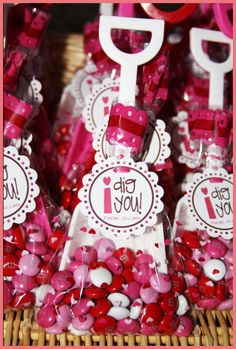 DIY..Valentine Goody Bags here is the link to print out the labels  pdf copy   https://docs.google.com/open?id=0B5WGmZzZZ-hydndmWGtqNHlkM2s  The plastic sand shovels are about 3 inches wide and 7 inches tall.     - Use a 2 inch scallopped punch.