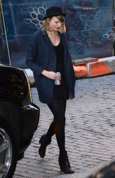Once again, the singer ditched color and print for a simple black and navy look. This time, she topped it all off with a bowler hat for that quintessential downtown-girl vibe.