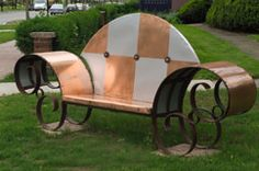Park bench made of copper over a wrought iron frame.