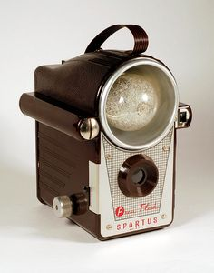 Spartus Press Flash Camera.         http://www.etsy.com/listing/100393061/rare-40s-spartus-press-flash-camera?ref=sr_gallery_1_search_query=Spartus+Press+Flash_view_type=gallery_ship_to=ZZ_min=0_max=0_search_type=all