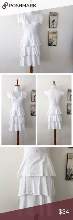 FLUXUS White cotton Tiered v-neck mini dress S EUC no flaws. Has some little balls of lint between the layers on top, can't really see them (see last photo) Minor wash wear Not sheer due to layers. Super soft lightweight cotton  Measurements will be added soon  📎Measurements are approximate  ✏️Save 15% on bundles of 3 or more 👍🏻Reasonable offers welcome  🚫Sorry no trades Fluxus Dresses Mini