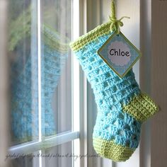 For Chloe's 1st Christmas      Stocking adapted from   free pattern from Bernat Handicrafter Crochet Thread - Teeny Tiny Stockings    Bern...
