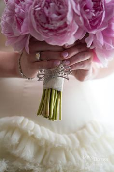 Bridal bouquet of pink peonies with memorial broach at the Fairmont Copley Plaza, Boston, MA. www.davidbarnesphotography.com