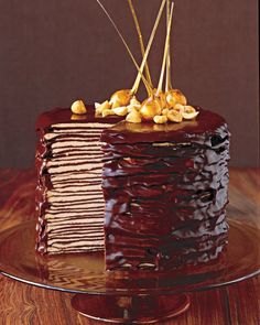 Darkest Chocolate Crepe Cake need to make vegan 3/4 cup (1 1/2 sticks) cold unsalted butter, cut into pieces, plus melted for pan 8 ounces semisweet chocolate, finely chopped 1 1/2 cups all-purpose flour 1/3 cup sugar 1/2 teaspoon salt 2 1/2 cups whole milk, room temperature 6 large eggs, room temperature 1 tablespoon pure vanilla extract Hazelnut Filling Chocolate Glaze Candied Hazelnuts