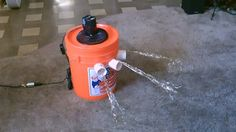 $15 homemade air conditioner. pvc pipe, small fan, styrofoam liner, bucket and ice.