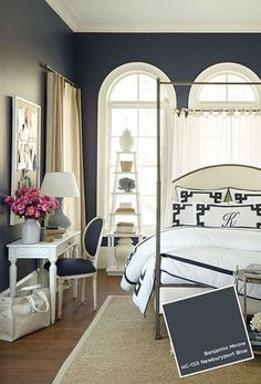 Newburyport Blue by Benjamin Moore makes a dramatic impact in this bedroom.