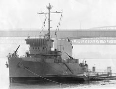 The USS Inaugural, a former Navy minesweeper, became a floating museum on the St. Louis riverfront in 1968. The 650-ton, 185-foot-long ship was built near Seattle in 1944 and saw action during the 1945 Battle of Okinawa. Robert E. O'Brien bought it from the Navy and brought it to St. Louis. It was there until the flood of 1993, which broke its moorings. The Inaugural was rescued and tied to a barge south of downtown, but sank Sept. 23, 1993. (Robert C. Holt Jr., St. Louis Post-Dispatch)