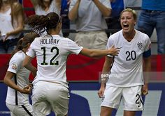 USA forward Abby Wambach (R) celebrates her goal with teammates Lauren Holiday and Tobin Heath during a Group C football match between Nigeria and USA at BC Place Stadium in Vancouver during the FIFA Women's World Cup Canada 2015 on June 16, 2015. AFP PHOTO/ANDY CLARK