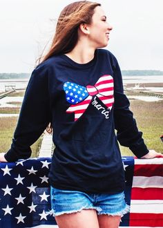 Wear our Ladies 'Merica Bow Tee out on the water this summer & around campus in the fall. This Classic United Tee has been a favorite for so many American Girls because of it's simple classy style & it's year round comfort & reliability. The American Flag will never go out of Style.