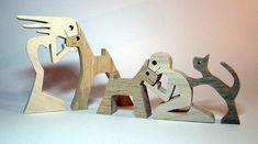 une femme un chien: femme en érable chien en chêne un enfant un chien un chat: enfant en érable chien en chêne chat en noyer