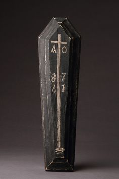 Finch & Co - A Memento Mori of a Carved Wooden Coffin