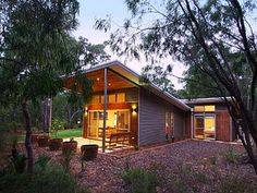 can extend shed to allow for a covered outdoor area and adjacent firepit/gathering zone