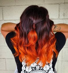 Hair colorist, Bre Ellis (@breellisofficial), painted a bright orange shade on the dark mane's ends, creating an eye-catching autumn hair. Wants this? Visit our website for more dark ombre styles! #darkombrehair #darkombrehaircolor Latest Hairstyles, Girl Hairstyles, Braided Hairstyles, Dark Ombre Hair, Ombre Hair Color, Split Dyed Hair, Hair Colorist, Fall Hair, Hair Looks
