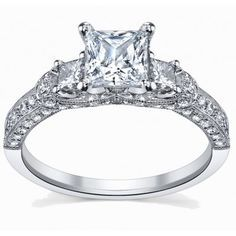 You search for Glamorous Cheap Engagement Ring stops here, you are looking at a finest and exclusive design by experienced jewelers at a price which fits your budget. This ornate diamond ring can be personalized to 10k, 14k or 18k white, yellow or rose gold and you can choose the center diamond from Princess Cut diamond or Round Cut diamond. The ring comes with a fancy jewelry box.
