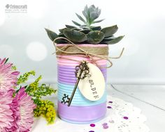 We love this upcycled plant pot made with the DecoArt Patio Paints! Learn how to make it with our Garden Craft tutorial!
