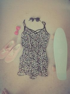 Cute  floral jumpsuit with pink vans and a bright pink hairbow. Perfect for summer and festival!