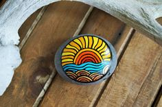 Hand Painted Rock with lanscape of sun, ocean and land. Painted stone. Red-yellow-blue-copper-gold-bronze. Beach art, home decor, office dec