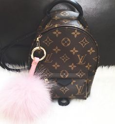 Give meeeeeeeeee ! I have the bigger LV back pack.  But not the mini and I love the mini.  I love my mini MK backpack purse, makes things soOooo much easier!