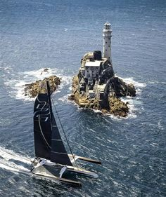 Spindrift 2 rounds the Fastnet Rock in the Rolex Fastnet Race 2013 photo copyright Kurt Arrigo / Rolex taken at and featuring the Trimaran class Catamaran, Lighthouse Pictures, Sail Away, Set Sail, Am Meer, Tall Ships, Sailing Ships, Ocean Sailing, Scenery