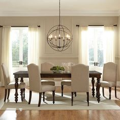Stylish dining room. The unique lighting fixture really stands out against the cream. Labor Junction / Home Improvement / House Projects / Dining Room / Lighting / House Remodels / www.laborjunction.com