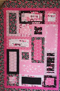Pattern Is modified Strips & Ladders.  Breast Cancer Quilt, fabric is Windham, Ribbons of Hope.  Gift to Heather Eaton.