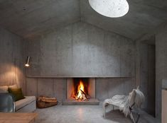 Minimalist Concrete Living Room Fireplace in Refugi Lieptgas