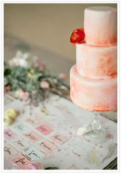 Love the cake and the escort cards. Convert this into blues and purples, hand make the cards, so cheap and easy Nd so beautiful. Then all I have to do is talk mom into writing the names on the cards for me....