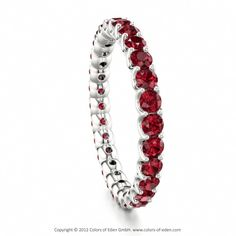 Would absolutely ADORE this with Emeralds instead!! - Ruby Eternity Ring Stardust #ruby #wedding #band