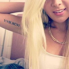 Roman Numerals on Girl's Arm - Cute Roman Numeral Tattoos, http://hative.com/cute-roman-numeral-tattoos/,