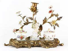 Antique French ink stand, bronze, with German porcelain winged cupid and inkwells
