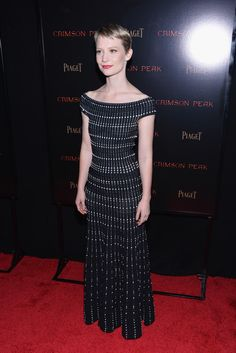 Mia Wasikowska Off-the-Shoulder Dress - Mia Wasikowska showed off her slender figure in a black-and-white off-the-shoulder knit gown by Alexander McQueen at the New York premiere of 'Crimson Peak.'