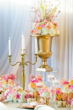 Gold candelabra surrounded by pretty flowers