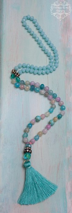 Silk Tassel Turquoise Necklace, Spring Gemstones Necklace, Pastel Colourful Boho Chic Necklace, Gift for her A Unique , beautiful, Pastel Hand knotted , Long Tassel Necklace . Features antique rhinestones, beautiful pastel agate faceted gemstones 8mm , turquoise gemstones ,