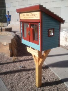 """History Colorado. Denver, CO. Our Little Free Library is located on the South side of our building on the corner of 12th & Lincoln St. in the Carol K. Gossard Memorial Garden. We built our library in our exhibit production shop. Our library's color scheme is modeled after our """"Summit Cafe"""" inside our Living West exhibit. Currently our library is featuring cookbooks to coincide with our upcoming exhibit, Food:Our Global Kitchen, which opens May 31."""