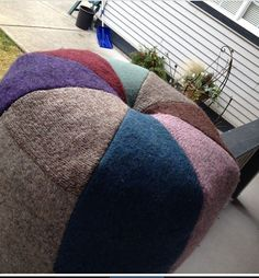 Pouf, made and stuffed with recycled sweaters.