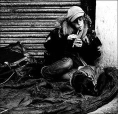 Photo caption: This young homeless girl was blowing a penny whistle outside the old Odeon cinema.