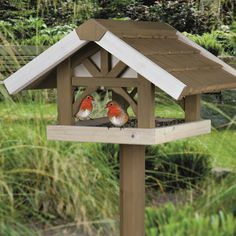 Bird feeders are a delightful addition to any bird-friendly backyard. Ideal for gardens, gazebos and balconies, this high-quality Trixie Nantucket Wooden Bird Feeder with Stand will attract finches, chickadees and other small birds.