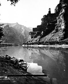 E.O. Beaman- 1871- Lighthouse Rock in Canyon of Desolation, Green River. The three boats are anchored near shore on leftside. Utah. August 11, 1871.