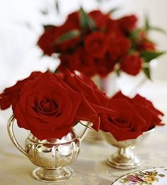 Red roses and silver vases
